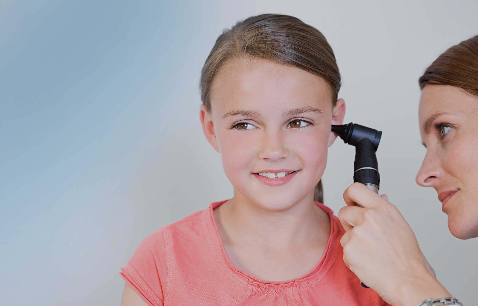 Girl having ear examination