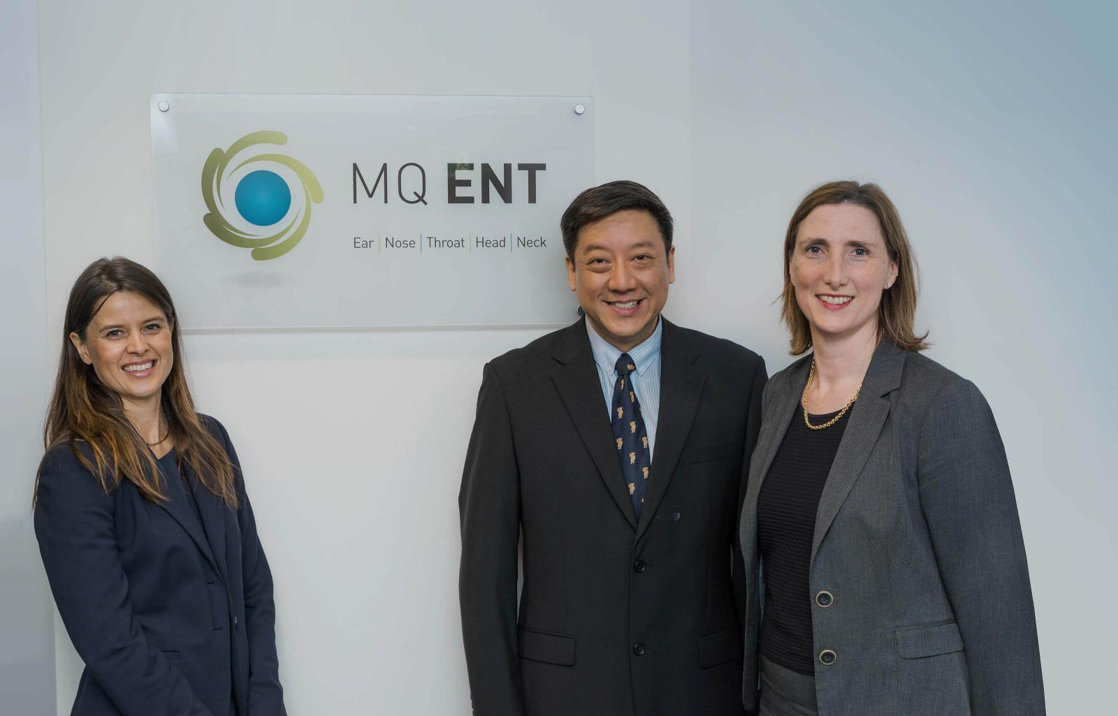 Team-members in front of MQ ENT sign